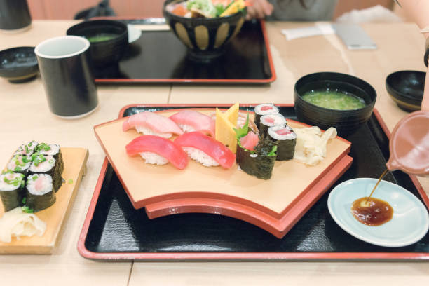 Close view of the typical Japanese red tuna sushi lunch set stock photo