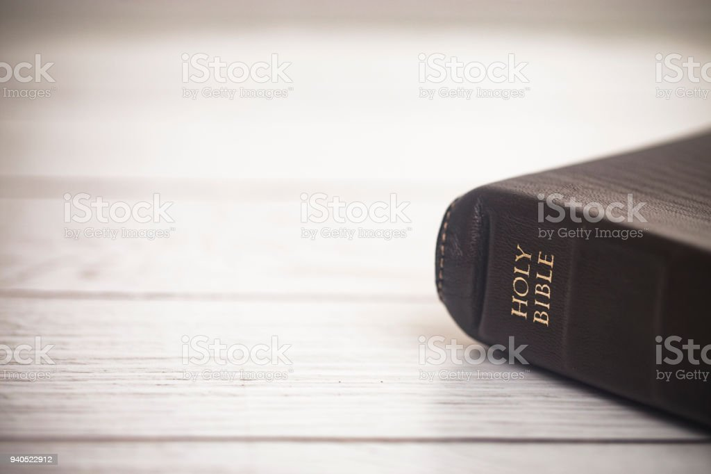 Closed Bible on a Wooden Table - foto stock
