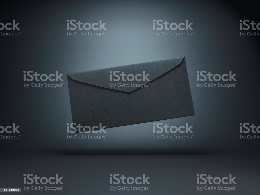 Closed Black paper envelope on black background stock photo