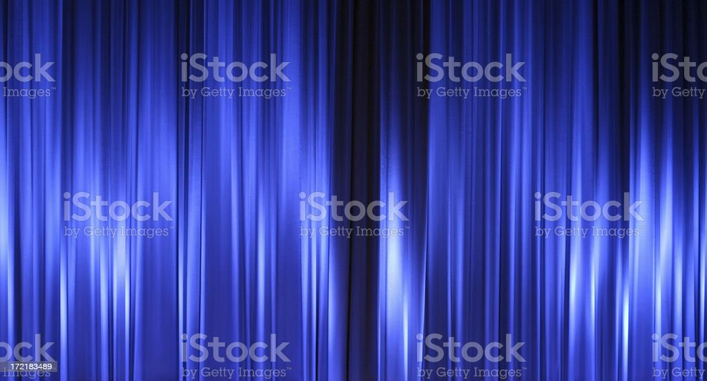 Closed blue curtains in a theatre, empty stock photo