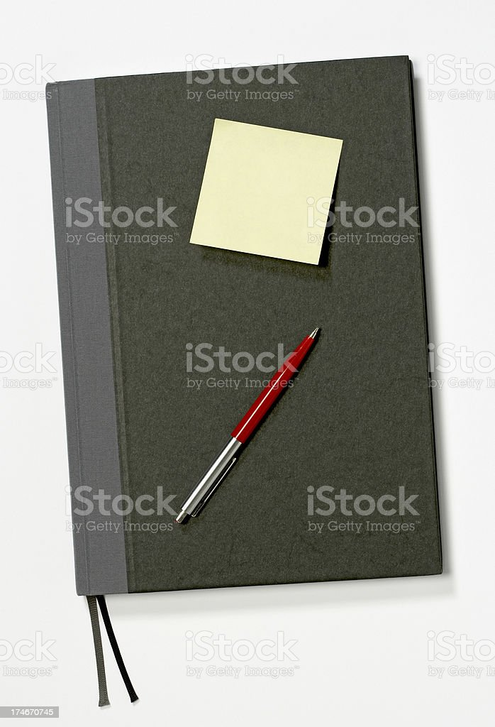 Closed book with post-it and pencil royalty-free stock photo