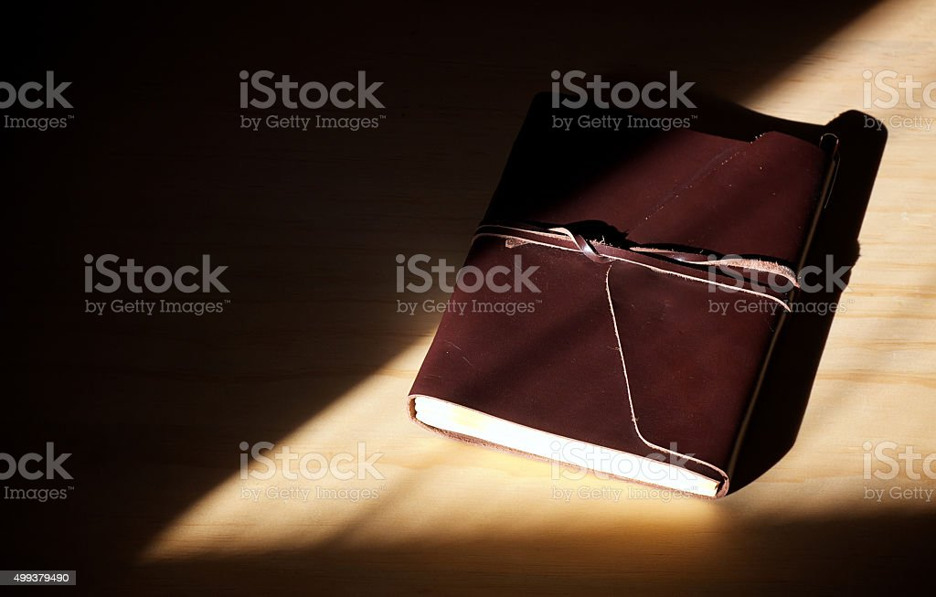 closed brown leather diary with flap and lacing stock photo