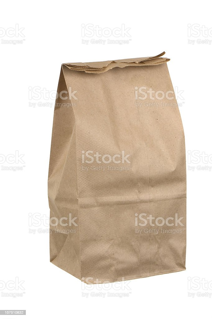 Closed brown paper lunch bag on white background stock photo