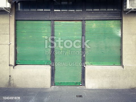 Buenos Aires, Argentina - August 20, 2017: Bar establishment with its blinds still closed during the day. It is not unusual for this businesses to open late during the day since they stay opened until late hours of the night