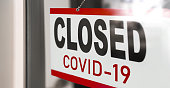 istock Closed businesses for COVID-19 pandemic outbreak, closure sign on retail store window banner background. Government shutdown of restaurants, shopping stores, non essential services 1220230580