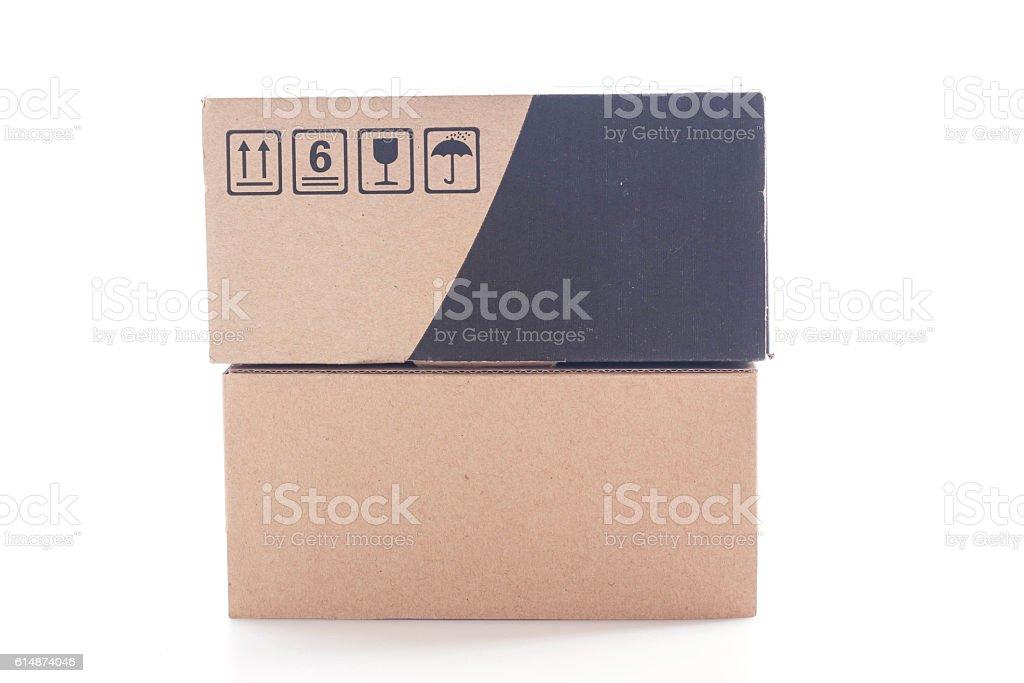 Closed cardboard box on white background. stock photo