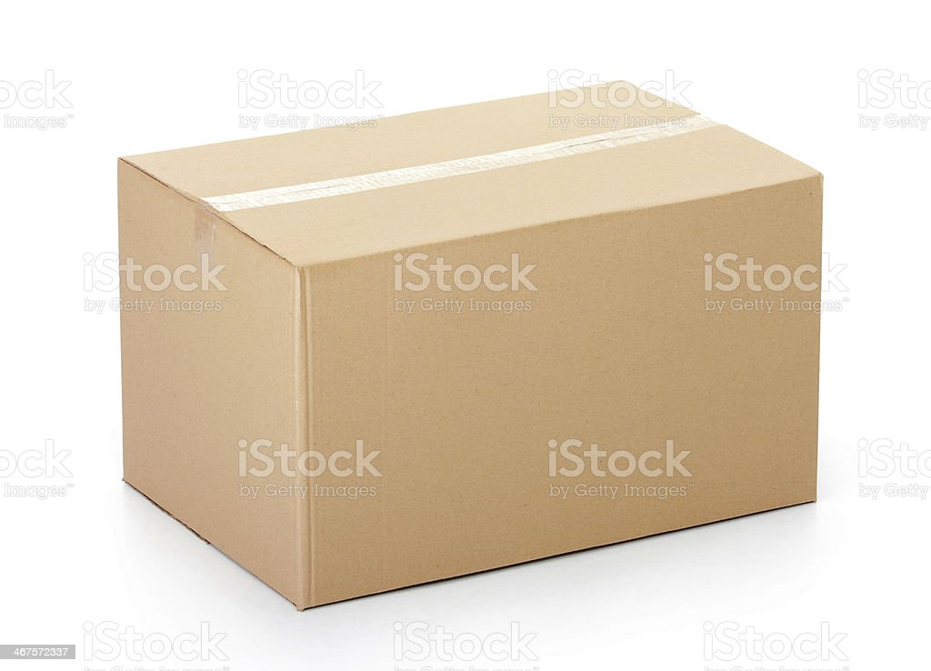 Closed cardboard box taped up against white background stock photo