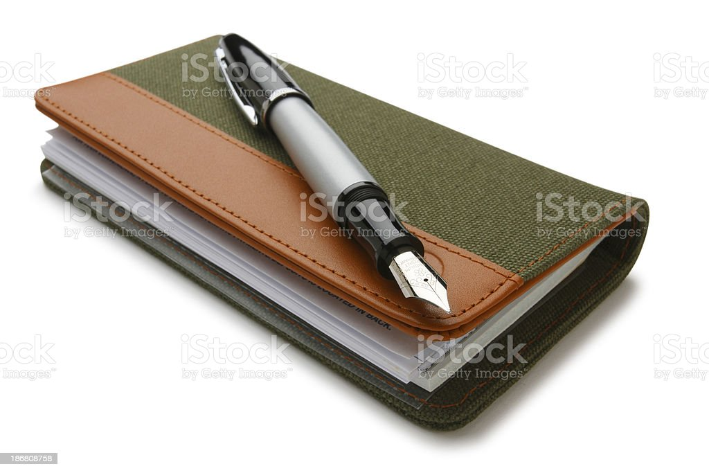 Closed checkbook and fountain pen on white background royalty-free stock photo