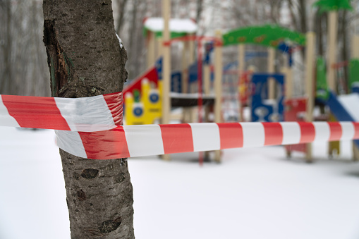 Closed children playground blocked by a barrier tape during a quarantine in Moscow
