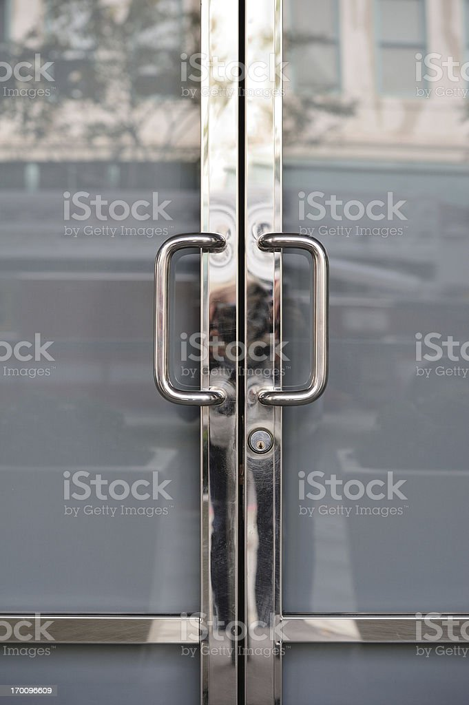 Closed. Chrome door handles of shop/office royalty-free stock photo