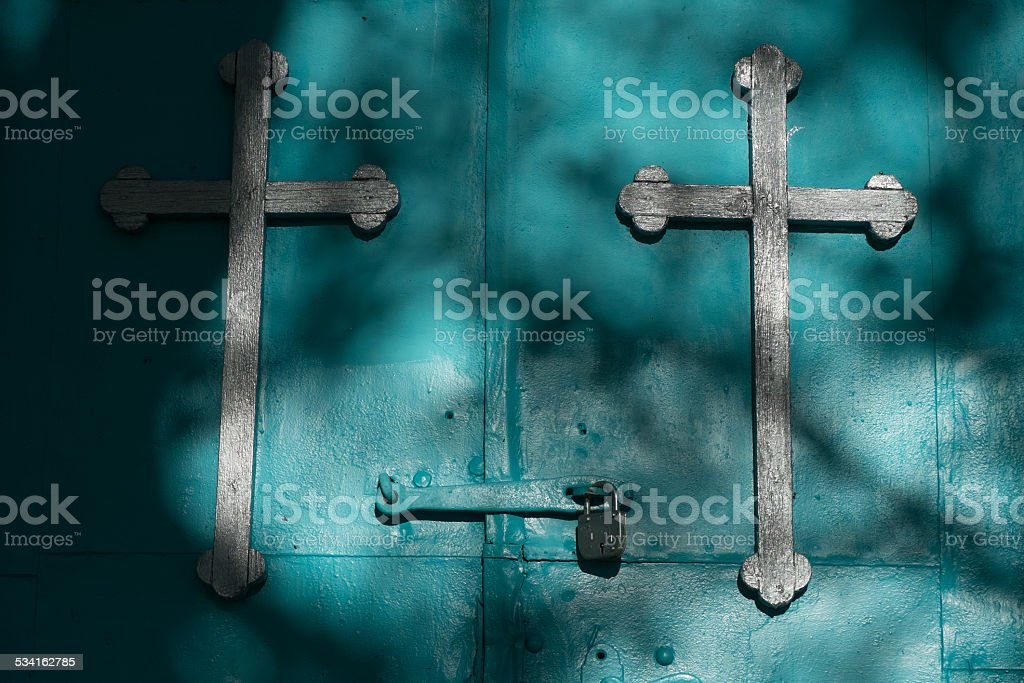 Closed church door with crosses stock photo