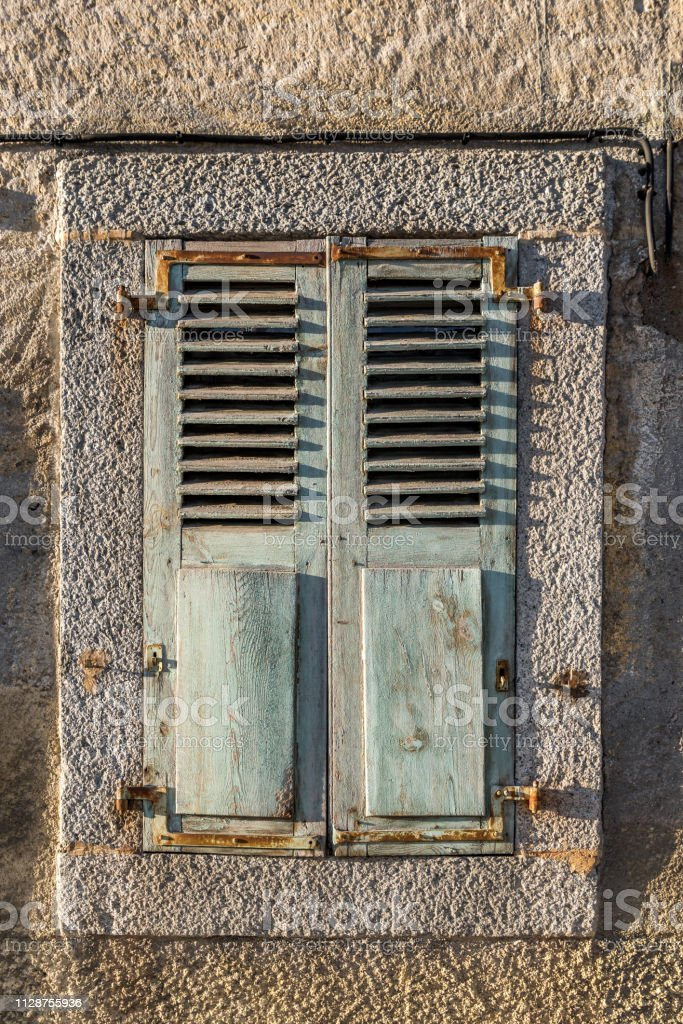 Closed Dilapidated Window Shutters With Metal Hinges In Stone Wall Stock Photo Download Image Now Istock