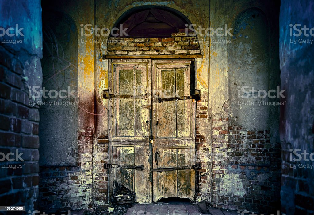 Closed door of old abandoned temple royalty-free stock photo