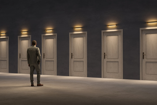 Too many closed doors, too many options, Businessman looking for the right door to exit, 3D - Computer generated image.