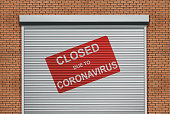 Red sign hanging at the shutter door saying \