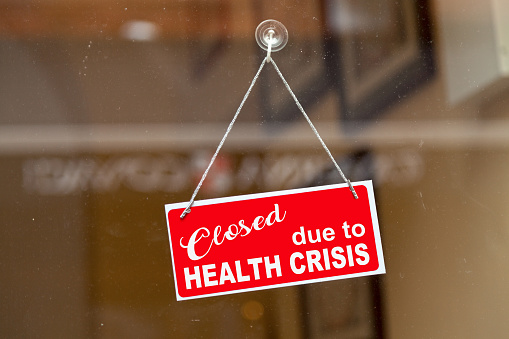 Closed Due To Health Crisis Closed Sign Stock Photo - Download Image Now