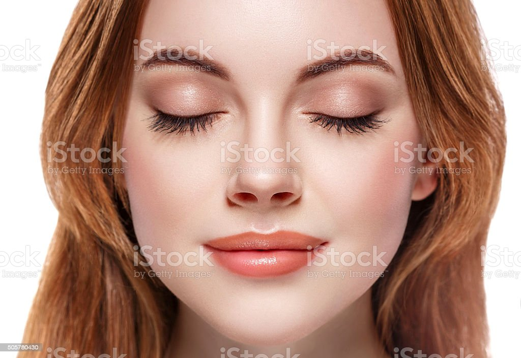 Closed Eyes Lashes Beautiful woman face close up portrait stock photo