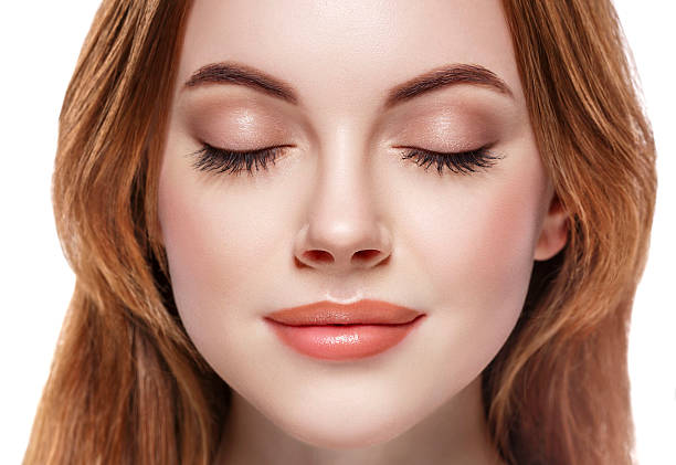 closed eyes lashes beautiful woman face close up portrait - close to stock photos and pictures