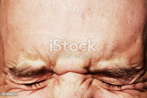 istock closed eyes squinting and forehead 91424211