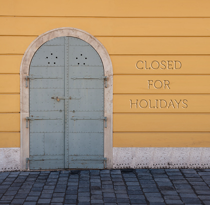 Closed for holidays Concept. Old  facade entrance