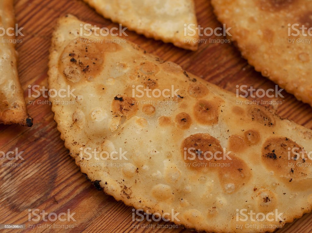 Closed fried pies with meat stock photo