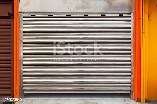 istock Closed garage metal roll gate, texture 1070023840