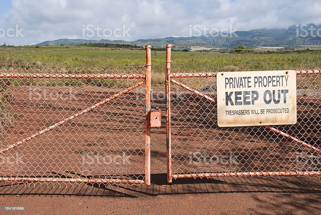 Closed gate at entrance to sugar cane field on Maui stock photo