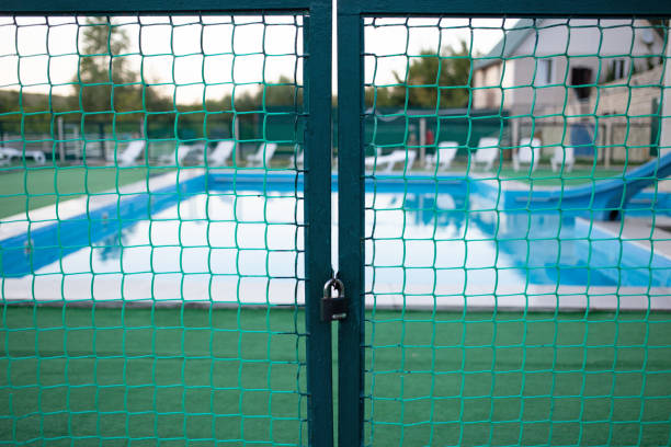 a closed gate at the entrance to the pool - standing water stock pictures, royalty-free photos & images