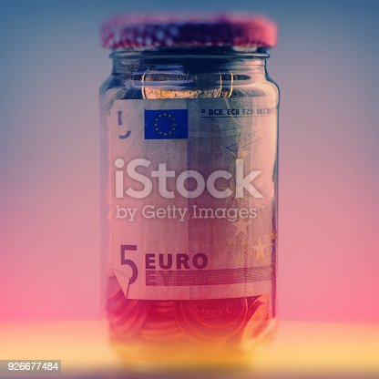 istock closed glass jar with euro coins and paper bills 926677484