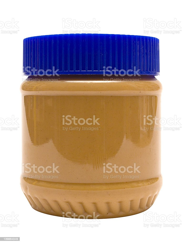 Closed Glass of Peanut Butter w/ Path (Side View) Delicious peanut butter. File contains clipping path. Brown Stock Photo