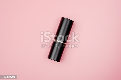 istock Closed lipstick tube, lip gloss top view. Glamorous makeup accessory on pink background. Beauty shop product. Feminine fashion style. Make up accessory, decorative cosmetics. 1173190931