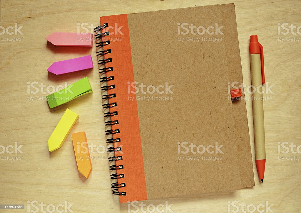 Closed notebook, pen and stickers royalty-free stock photo