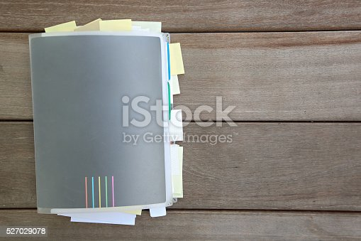 istock Closed notebook with many sticky notes inside 527029078