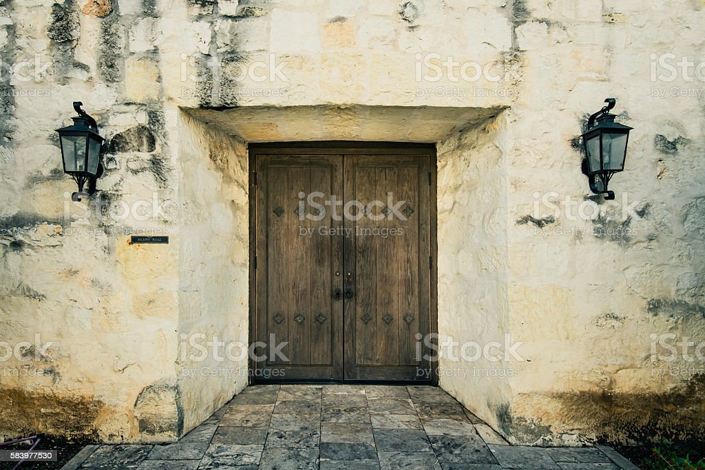 Closed old door on the wall of The Alamo stock photo