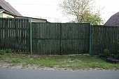 istock closed old wooden green gate 1226627754