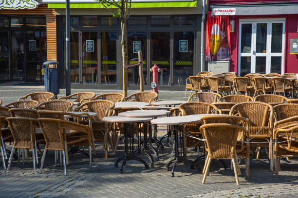 """Neuwied, Germany - April 8, 2020: closed pub """"Borsalino""""  with empty chairs and tables in front based on Corona pandemic"""
