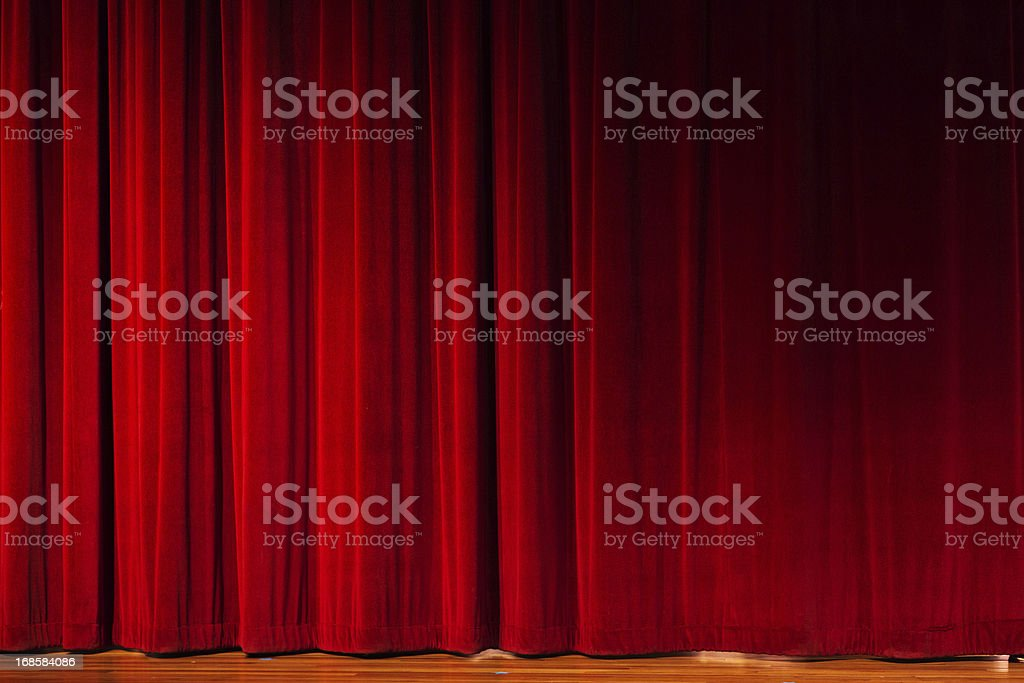 Closed red curtains over theater stage stock photo