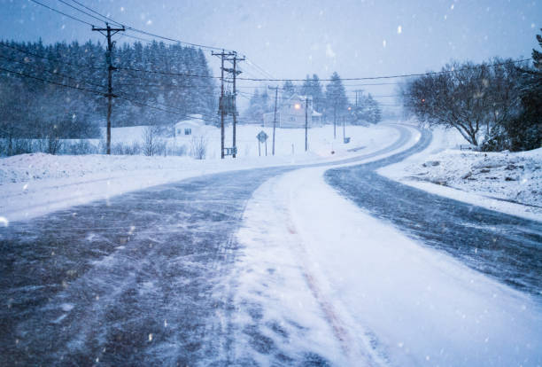 Closed Road because of Bad Weather and Visibility during Winter Blizzard. stock photo