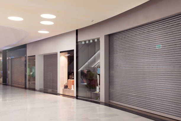 Closed shopping mall stores stock photo