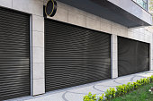 Closed Shop due to lockdown With Black metal roller shutter door