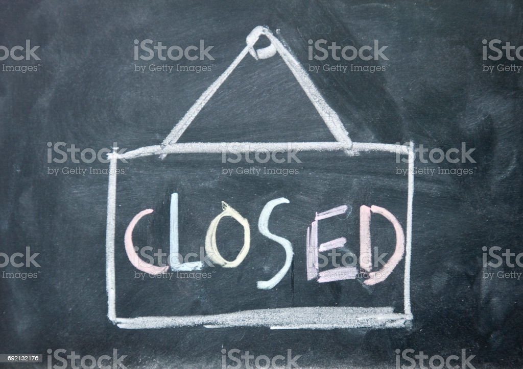 closed sign drawn with chalk on blackboard stock photo