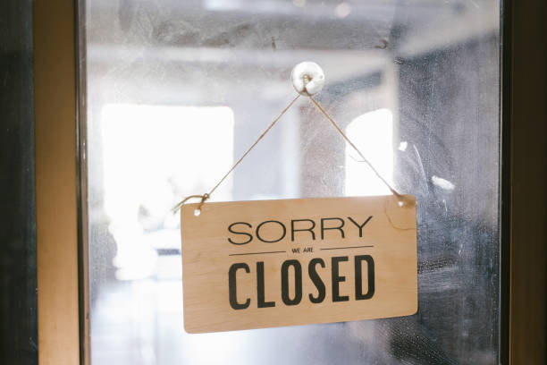 Closed sign handing on glasses door of cafe stock photo