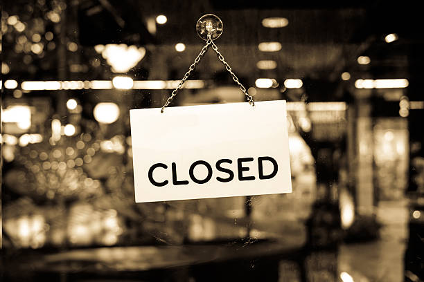 closed sign hanging in a shop window - closed stock photos and pictures