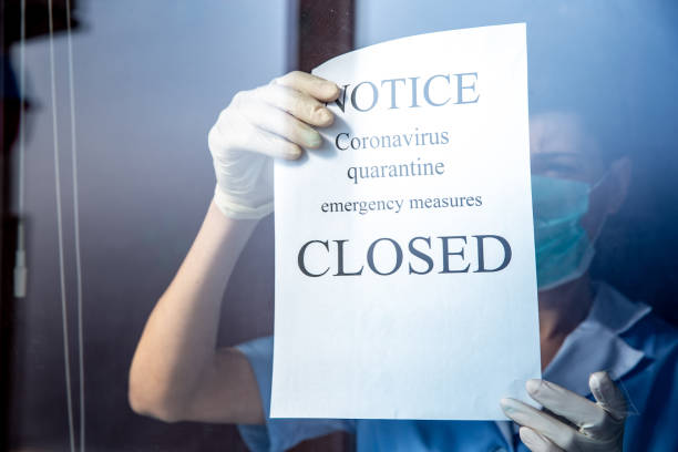 Closed sign notice for epidemic Coronavirus on window stock photo