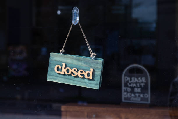 Closed sign on a restaurant stock photo