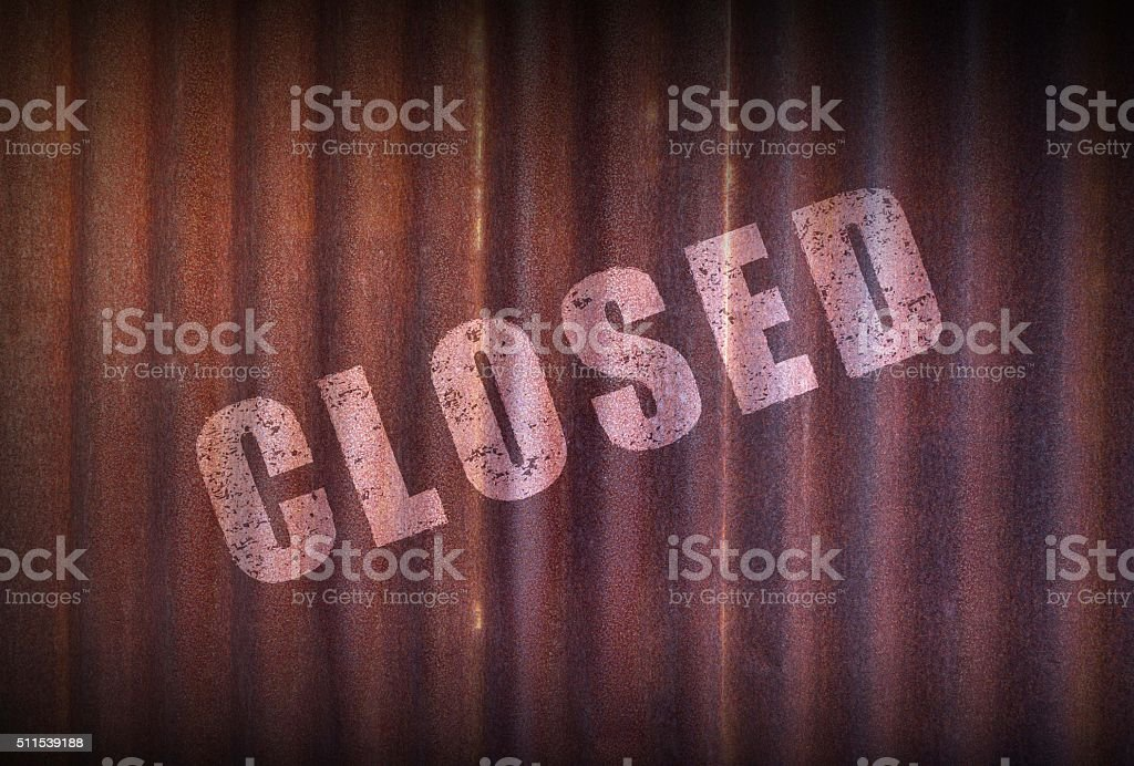 Closed sign on old zinc sheet rust background. stock photo