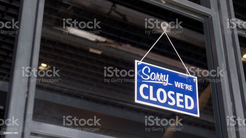 Closed sign on the shop's window stock photo