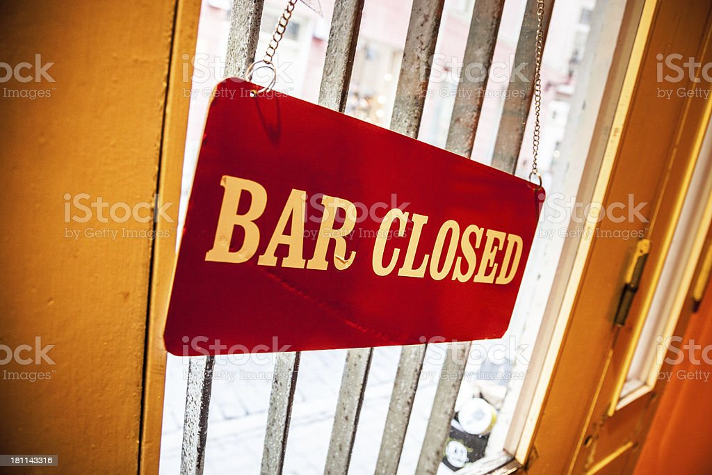 Closed sign outside a bar entrance door royalty-free stock photo