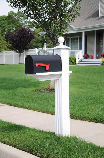 Closed Suburban Residential Mailbox Lush Green Lawn stock photo
