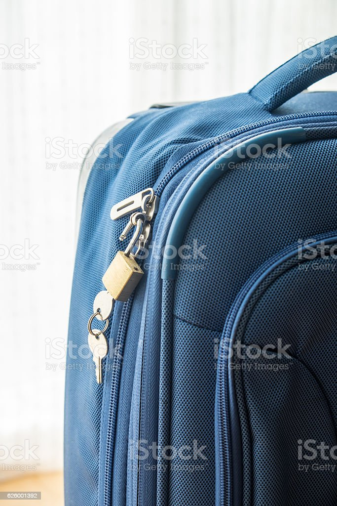 Closed suitcase in the room. stock photo